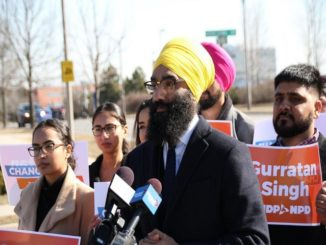 Gurrartan Singh, NDP candidate carried 'F--- the police' protest sign