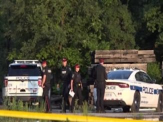 Burning car with a body inside found in open lot, Mississauga