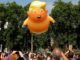 "Protesters gather in London for anti-Trump rallies with giant ""Trump baby"" balloon"
