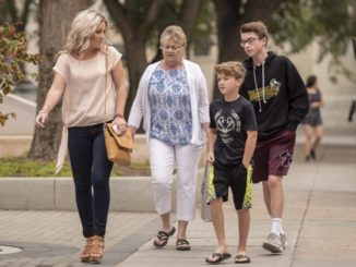 Christina Haugan, left to right, wife of deceased Darcy Haugan, head coach of the Humboldt Broncos, with her two sons Jackson, 9, and Carson, 13, prior to a court hearing related to money raised following the Humboldt Broncos bus crash outside the Court of Queens Bench in Saskatoon.