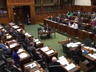 Protesters rally outside Ontario legislature during rare midnight sitting