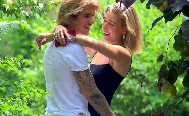 Hailey Baldwin and Justin Bieber are pictured in New York after denying courthouse wedding